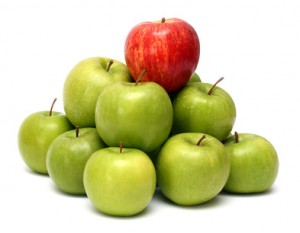One red apple on top of 8 green apples