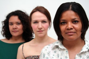 Three women, faces only